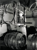 Worker in Front of Some Isobarometric Equipment Inside a Brewery Photographic Print by A. Villani