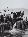 Fisherman Armed with Harpoons Hoisting a Tuna on Board their Boat Photographic Print by A. Villani