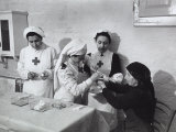 Nurse Attending to an Elderly Woman in a Hosptial During World War II Photographic Print by A. Villani