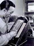 Close-up of a Worker with a Stethoscope, Checking the Perfection of an Accordion under Production Photographic Print by A. Villani