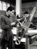 Technician Grinding a Piece of Metal Inside a Caproni Hangar Photographic Print by A. Villani