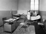 Medical Exam Inside the Giovanni XXIII Institute, Rest and Recreation Home for the Elderly Photographic Print by A. Villani