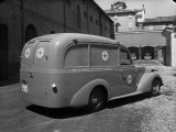 Red Cross Ambulance Parked on a Street in Bologna Photographic Print by A. Villani