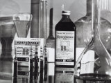 The Medicine Eparabrene in Vials and Bottles of Syrup with Some Laboratory Test Tubes Photographic Print by A. Villani