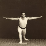 Portrait of a Young Gymnast as He Performs an Exercise Photographic Print by Carlo Wulz