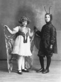 Portrait of Two Children in Carnival Costumes, She is a Butterfly, He is a Caterpillar Photographic Print by Carlo Wulz