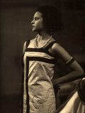 Portrait of Marion Wulz Wearing a Long, Sleeveless Dress, Large Necklace and Bracelets Photographic Print by Carlo Wulz