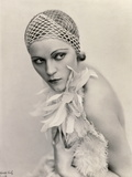 Portrait of a Woman Wearing a Fishnet Hat and a Feather Boa Photographic Print by Wanda Wulz