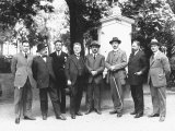 Group Portrait of Men in Front of a Funeral Monument Photographic Print by Carlo Wulz