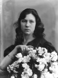Portrait of a Young Woman with a Bunch of Flowers Photographic Print by Carlo Wulz