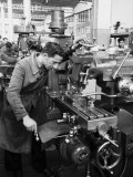 Worker Working at Various Machines in the Innocenti Automobile Factory Fotografie-Druck von A. Villani