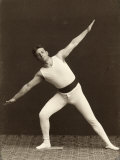 Portrait of a Gymnast as He Performs an Exercise Photographic Print by Carlo Wulz