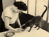 Wanda Wulz Preparing Food for Her Cat Pippo Photographic Print by Marion Wulz