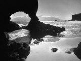 Natural Gateways Formed by the Sea in the Rocks on the Coastline Fotografisk tryk af Eliot Elisofon
