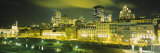 Buildings in a City Lit Up at Night, Auberge Du Vieux Port, Montreal, Quebec, Canada Photographic Print by  Panoramic Images