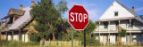 Stop Sign in Front of a House, Tierra Amarilla, Carson National Forest, New Mexico, USA Photographic Print by  Panoramic Images