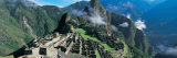 View of Ruins of Ancient Buildings, Inca Ruins, Machu Picchu, Peru Papier Photo par  Panoramic Images