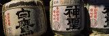 Close-up of Three Dedicated Sake Barrels, Imamiya Temple, Kita-Ku, Kyoto, Honshu, Japan Photographic Print by  Panoramic Images