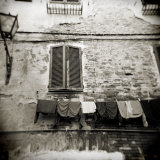 Laundry Hanging from Wall of Old Building, Siena, Tuscany, Italy Photographic Print by Lee Frost
