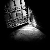 Detail of Window with Ornate Iron Grille and Sunlight Streaming Through, Morocco Photographic Print by Lee Frost