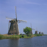 Windmills on the Canal at Kinderdijk Near Rotterdam, UNESCO World Heritage Site, the Netherlands Photographic Print by Roy Rainford