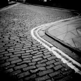 Winding Cobbled Street with Double Yellow No Parking Lines, Edinburgh, Scotland, UK Photographic Print by Lee Frost