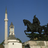 Statue of Skanderberg with the Clock Tower and Minaret of the Mosque Beyond in Tirana, Albania Photographic Print by Rolf Richardson
