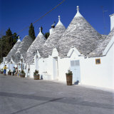 Trulli Houses of Alberobello, UNESCO World Heritage Site, Puglia, Italy, Europe Photographic Print by Tony Gervis