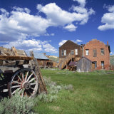 Old Farm Wagon and Derelict Wooden and Brick Houses at Bodie Ghost Town, California, USA Photographic Print by Tony Gervis