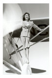 Stewardess Balancing on Plane Wheel Prints