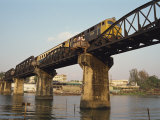 Train Crossing the River Kwai Bridge at Kanchanburi in Thailand, Southeast Asia Photographic Print by Charcrit Boonsom