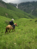 Tourist on Horseback in the Aksu Dzhabagly Reserve, Tien Shan Mountains in Kazakhstan, Central Asia Photographic Print by Nigel Callow