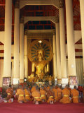 Monks Kneel before a Statue of the Buddha in Wat Phra Sing in Chiang Mai, Thailand, Southeast Asia Photographic Print by Charcrit Boonsom