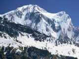 Snow Covered Peak of Annapurna in the Himalayas, Nepal Photographic Print by Nigel Callow