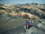 Tourists Walking across Volcanic Landscape, Mainly Rhyolite, at Landamannalaugar in Iceland Photographic Print by Nigel Callow