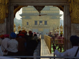 Sikhs at the Entrance to the Golden Temple, Crossing Guru's Bridge, Amritsar, Punjab, India Photographic Print by Jeremy Bright