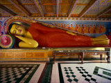 Recumbent Buddha in the Isurumuniya Temple, Anuradhapura, Sri Lanka Photographic Print by David Beatty