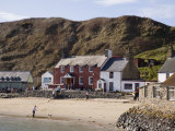 Ty Coch Inn on Beach at Porth Dinllaen Village in Bay on Lleyn Peninsula, North Wales, UK Photographic Print by Pearl Bucknall