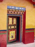 Traditional Painted Door in the Summer Palace of the Dalai Lama, Norbulingka, Lhasa, Tibet, China Photographic Print by Gina Corrigan