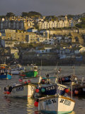 Stormy Sky at Sunset with Small Fishing Boats in the Harbour at St. Ives, Cornwall, England, UK Photographic Print by Neale Clarke