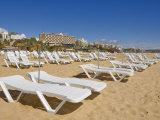 Empty White Sun Lounger Sunbeds on Praia Da Rocha Beach, Portimao, Algarve, Portugal, Europe Photographic Print by Neale Clarke