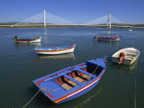 Tranquil Scene of Fishing Boats and Suspension Bridge, Portimao, Algarve, Portugal, Europe Photographic Print by Neale Clarke