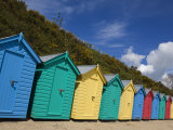 Multicoloured Beach Huts on the Long Sweeping Beach of Llanbedrog, Llyn Peninsula, Gwynedd, Wales Photographic Print by Neale Clarke