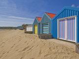 Multicoloured Beach Huts, Morfa Gors Beach, Borth Fawr, Llyn Peninsula, Gwynedd, North Wales Photographic Print by Neale Clarke