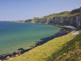 Carrick Island in Larrybane Bay, North Antrim Causeway Coast Way, County Antrim, Northern Ireland Photographic Print by Neale Clarke