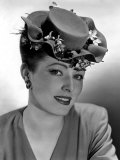 Eleanor Parker, Wearing a Flat-Crowned, Double-Brimmed Hat Nestled with Violets, 1944 Posters