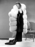 Claudette Colbert, in Travis Banton Gown and White Fox Fur Coat, c.1935 Prints