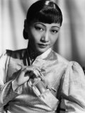 Anna May Wong, in an Orange Nanking Brocade Robe with Sandalwood Fastenings, 1937 Photo