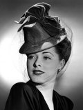 Eleanor Parker Wearing a Tall Crowned Chapeua Made of Felt with Velvet Bows, 1943 Print