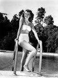 Rita Hayworth Relaxes at Home Via a Dip in the Pool, 1946 Photo